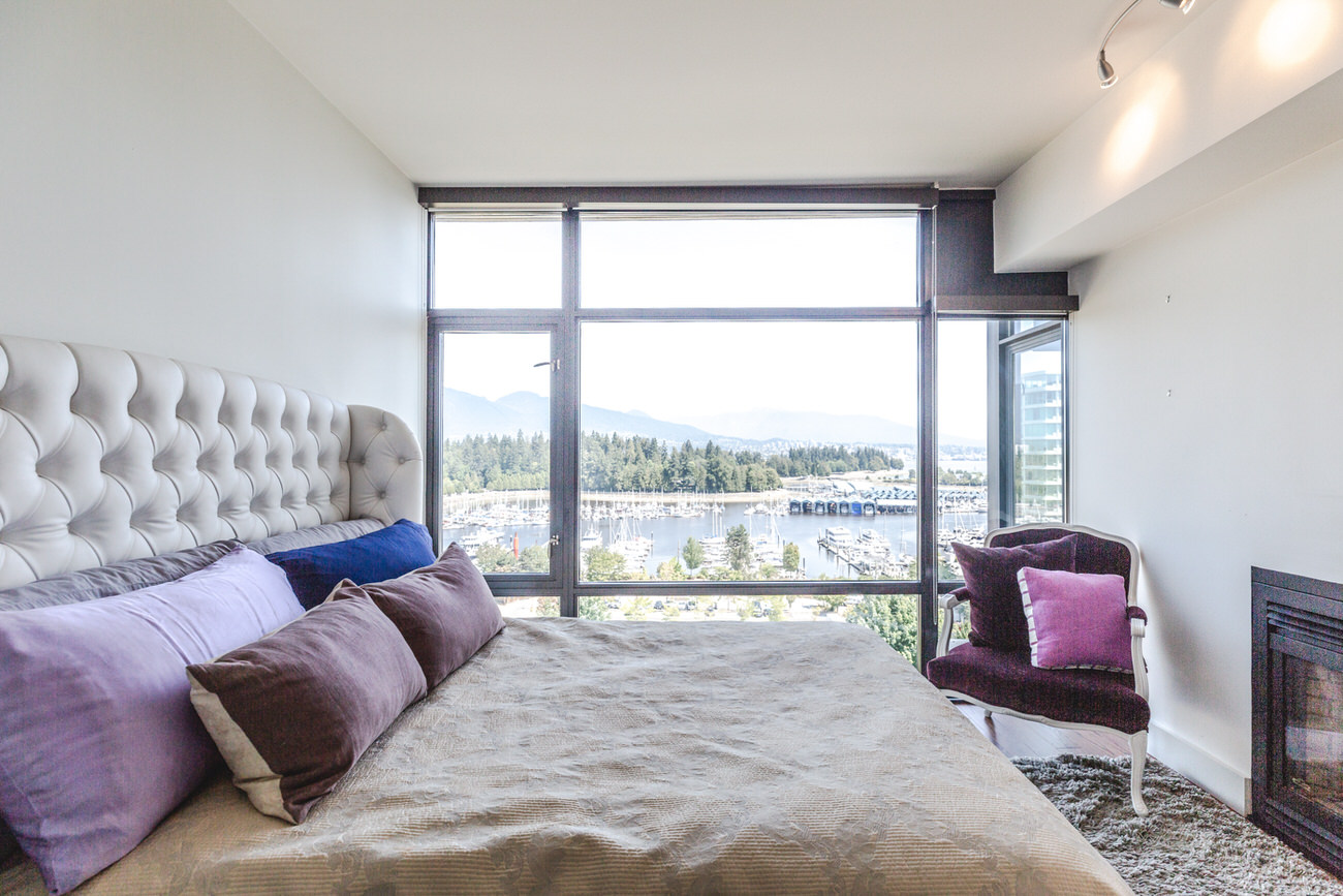 Furnished bedroom in Downtown Vancouver condo with view.