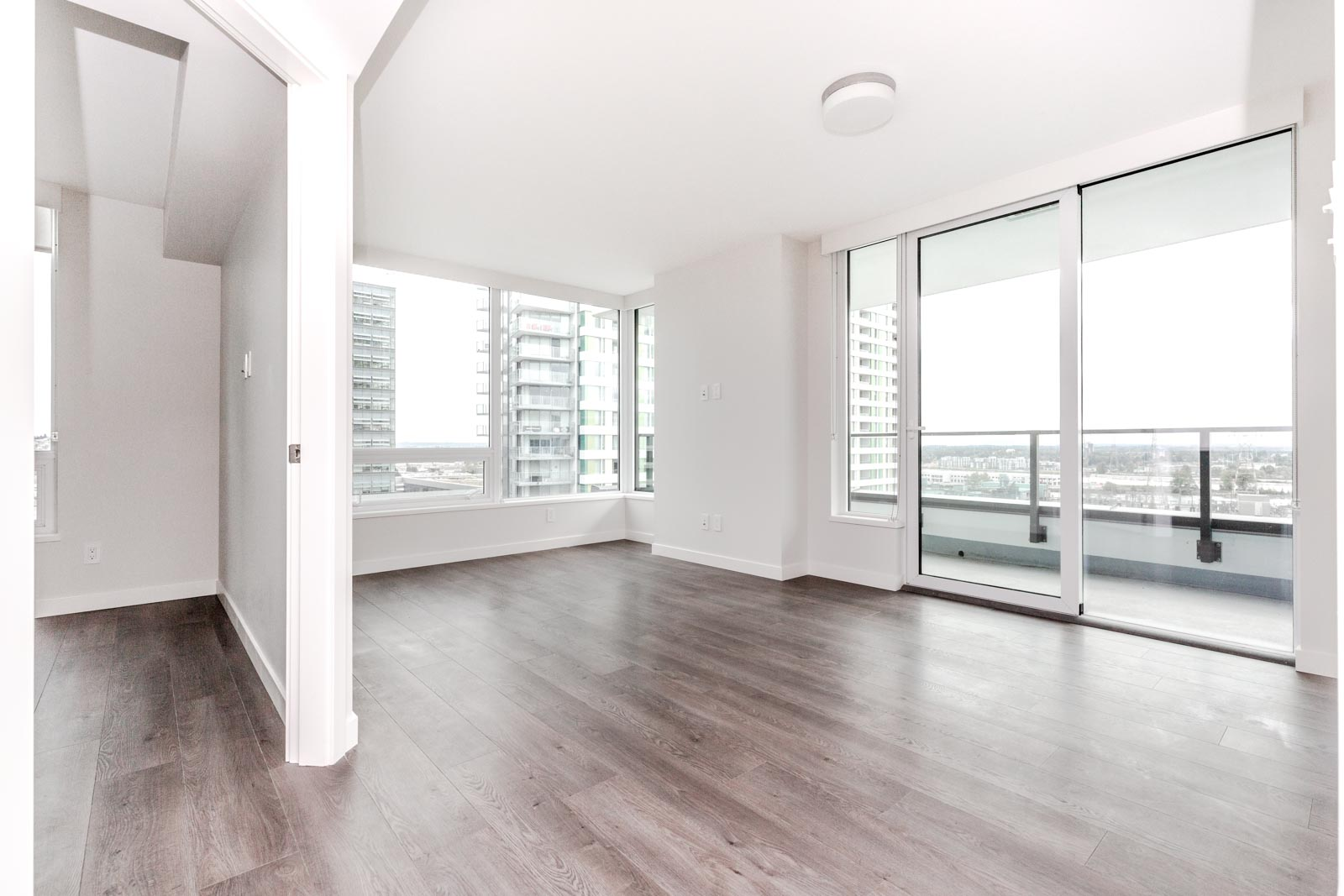 Living area of Vancouver luxury rental condo with view.