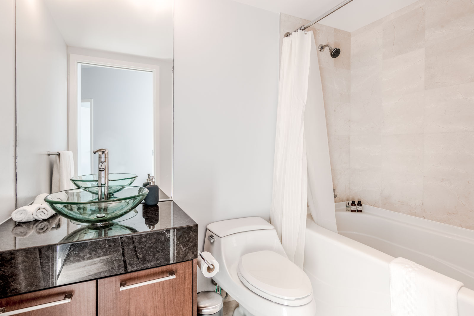 White Bathroom in Olympic Village Condo Listed by Property Management Company Birds Nest Properties