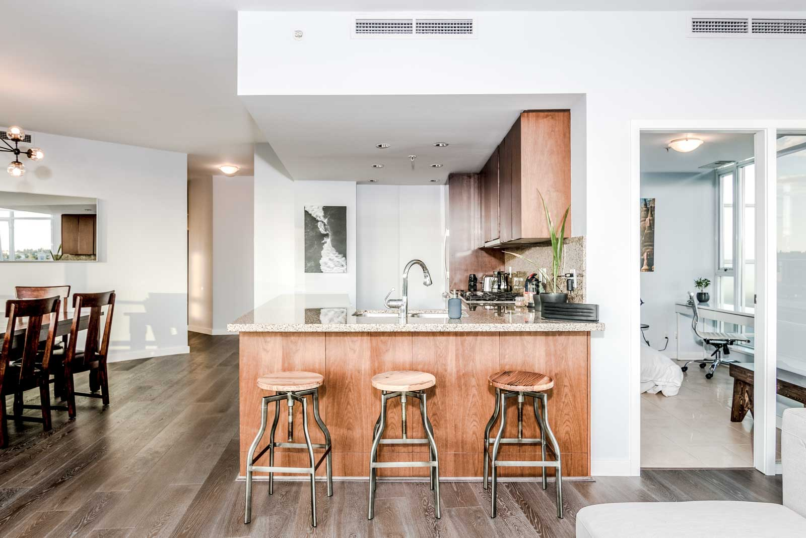 Kitchen with Bar Stools in Olympic Village Vancouver Rental at 918 Cooperage Way