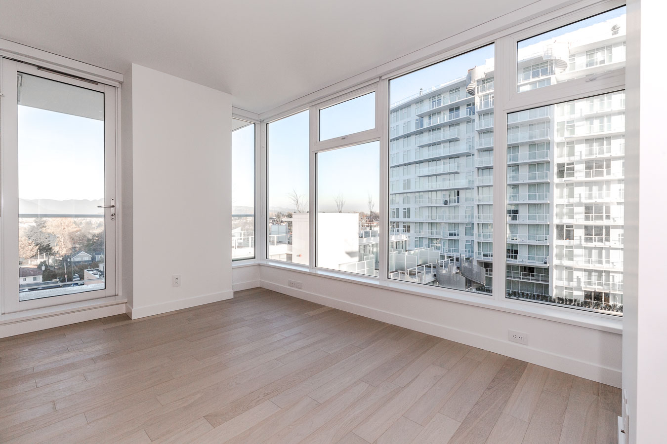 Bedroom with ash flooring at Vancouver condo rental with a view.