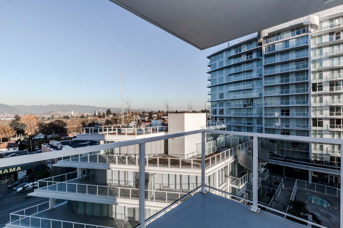 Private balcony offering view of Vancouver at luxury condo rental managed by Birds Nest Properties.