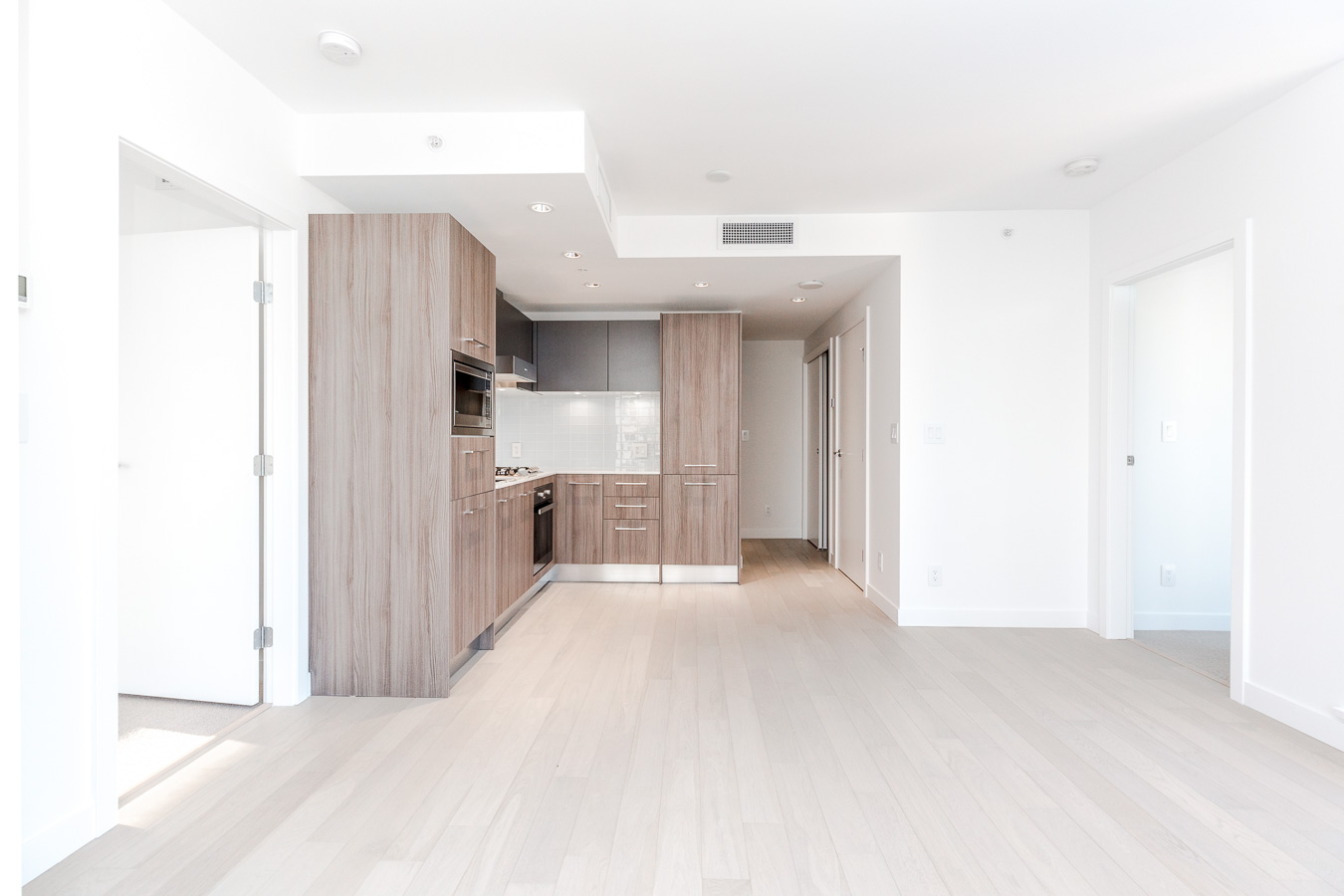 Kitchen and dining area at brand new Vancouver condo rental managed by Birds Nest Properties.