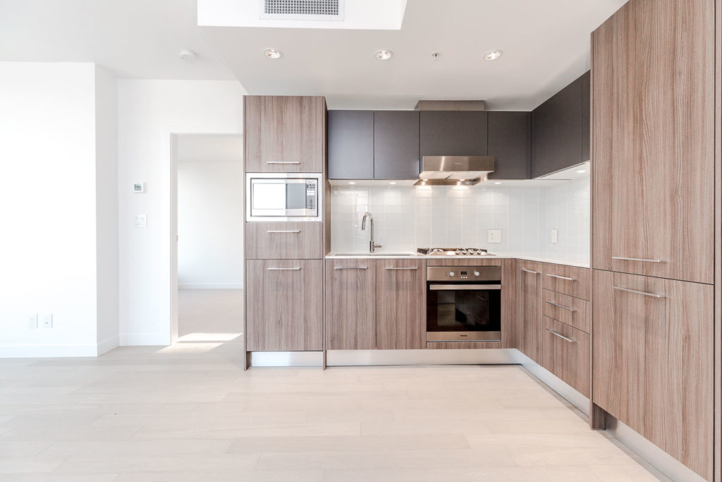Kitchen with stainless steel appliances at Vancouver condo rental.