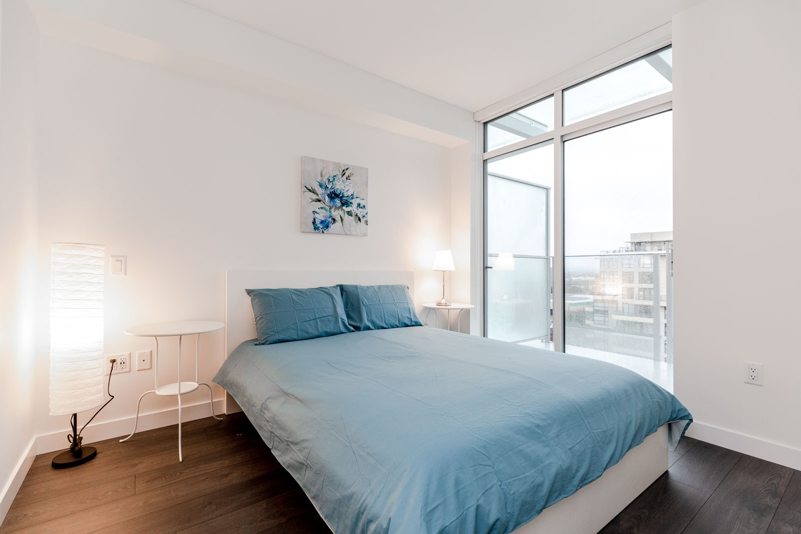 Bedroom With Blue Duvet at Richmond Condo For Rent