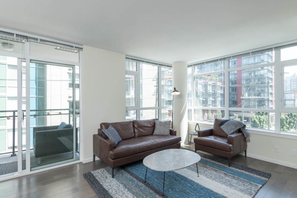 Furnished living area inside Vancouver rental condo with view.