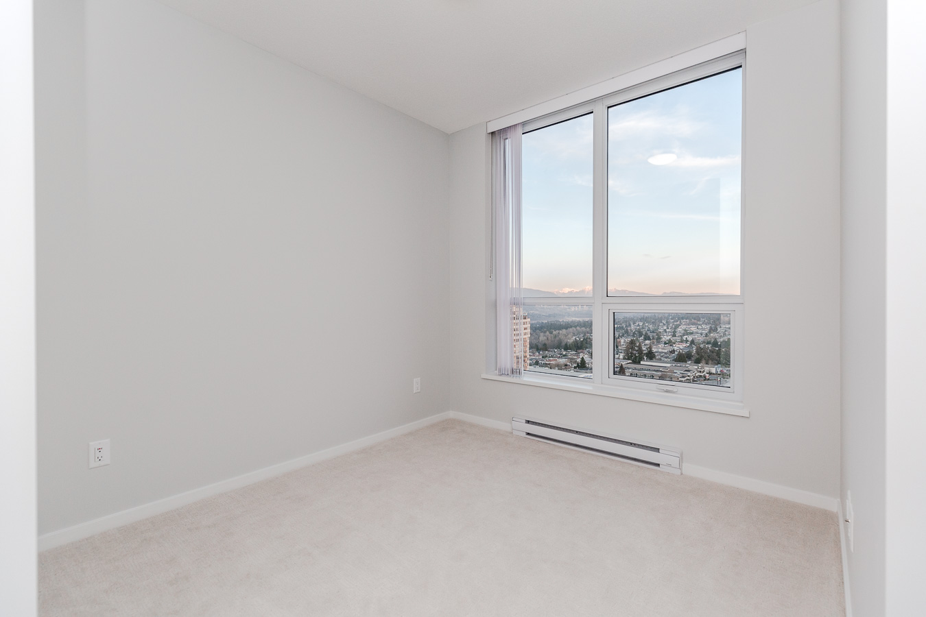 Bedroom with a view in Metrotown condo managed by Birds Nest Properties.