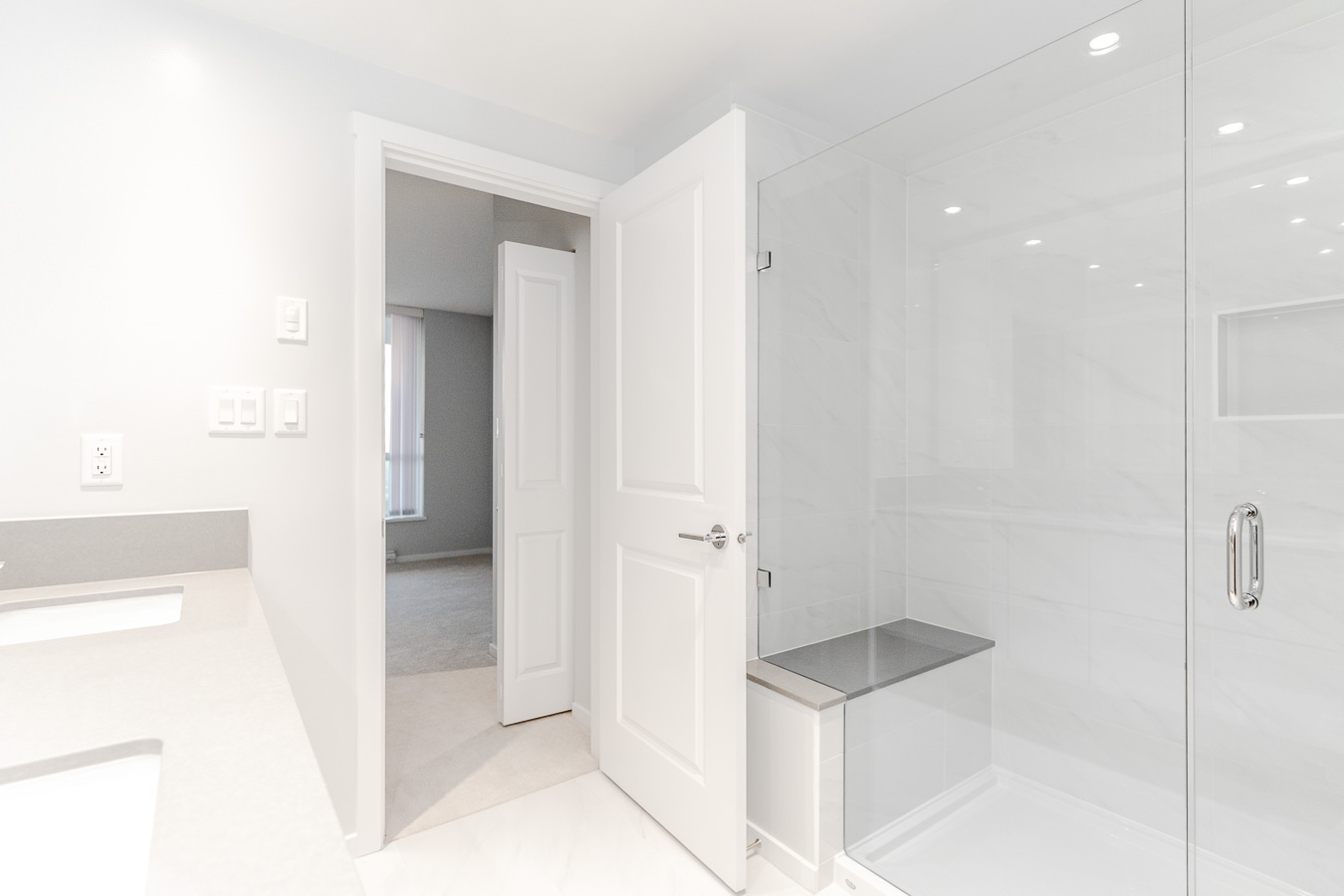 Bathroom with walk-in shower at Metrotown rental condo.