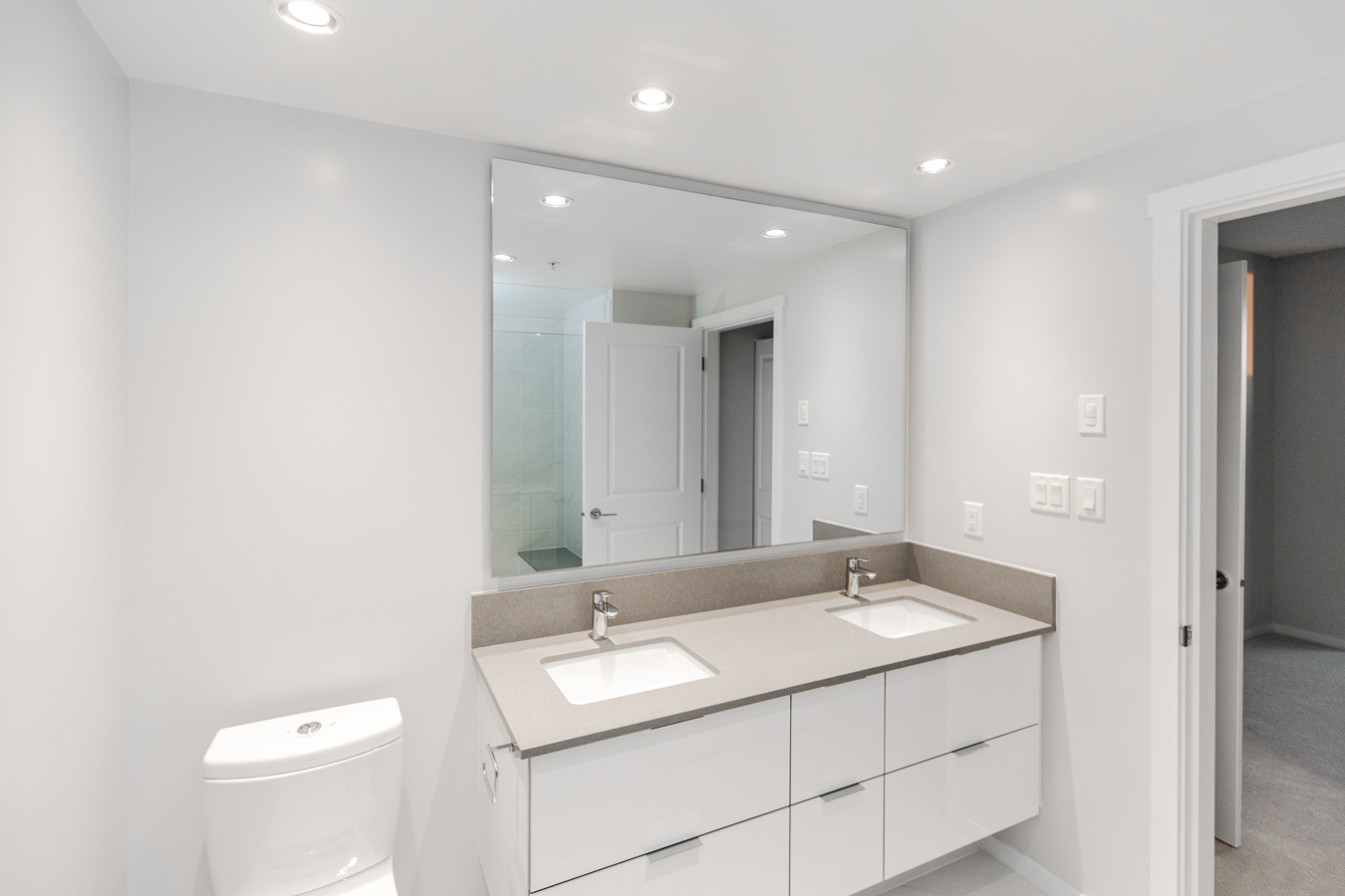 Two sink bathroom at Metrotown rental condo managed by Birds Nest Properties.
