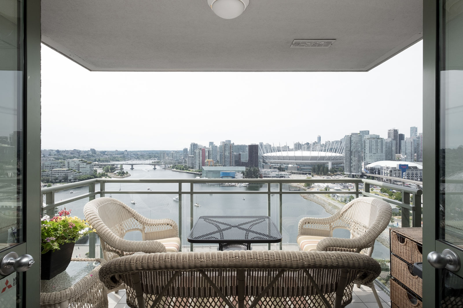 Private balcony of furnished Vancouver rental overlooking waterfront.