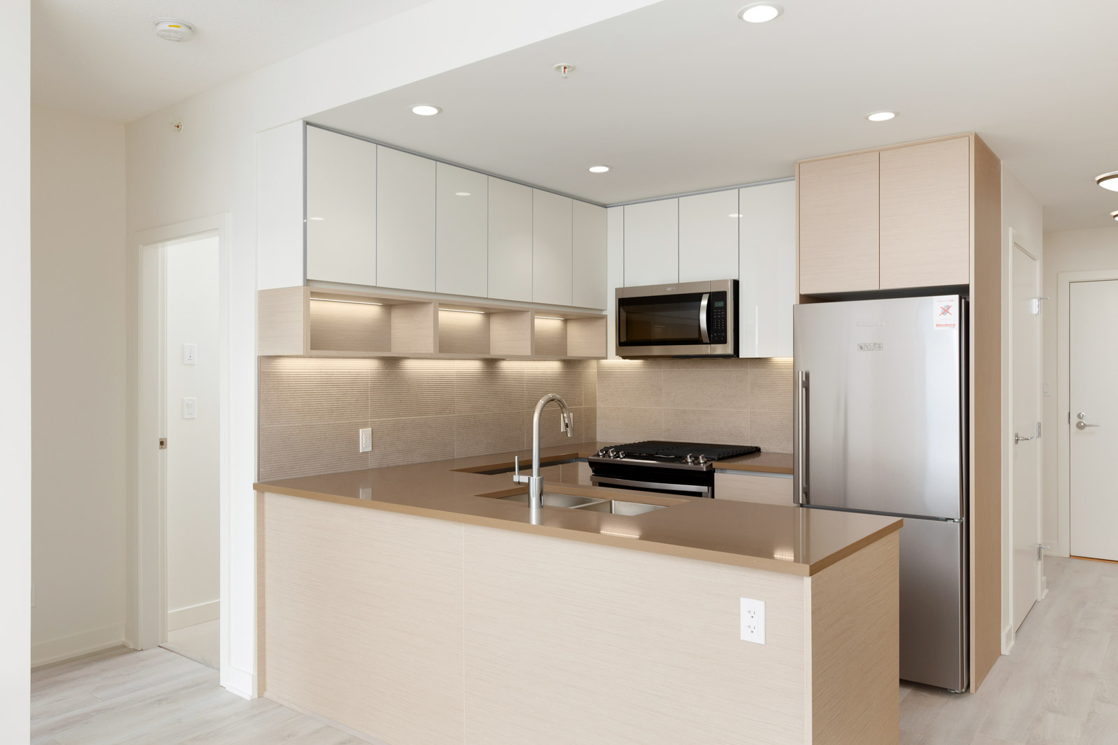 Newly built kitchen with oak and white cabinetry from Burnaby Mountain condo rental..