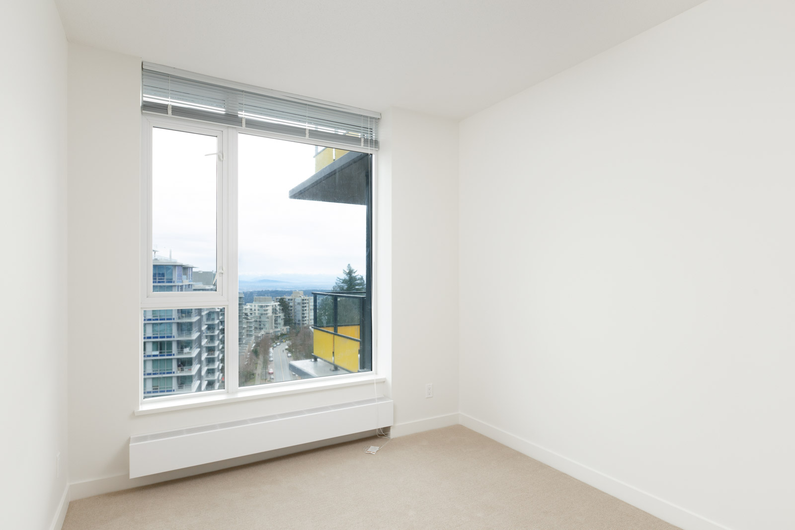 Bedroom with view at Burnaby Mountain condo rental managed by Birds Nest Properties.