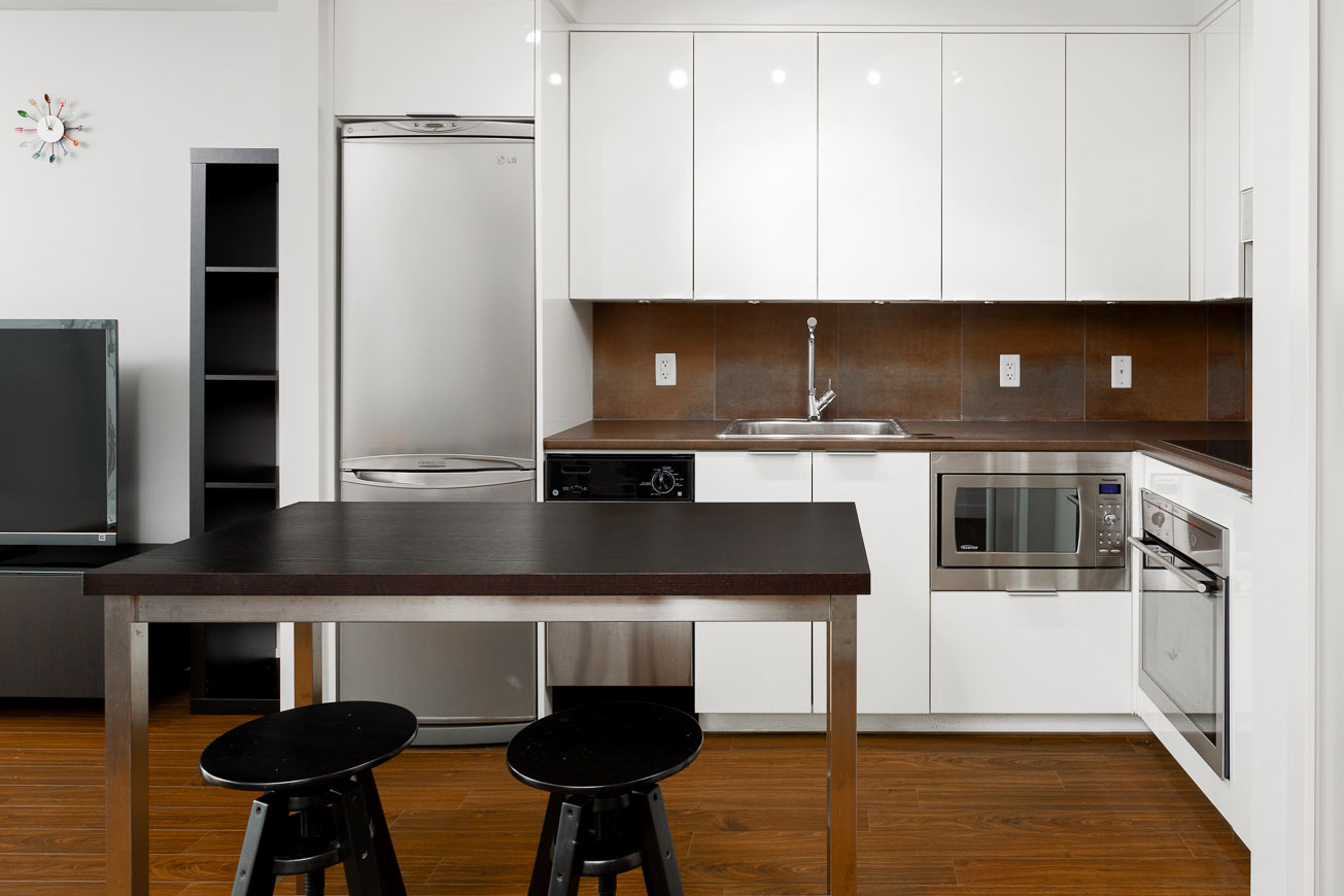 Kitchen with stainless steel appliances at Downtown Vancouver condo.