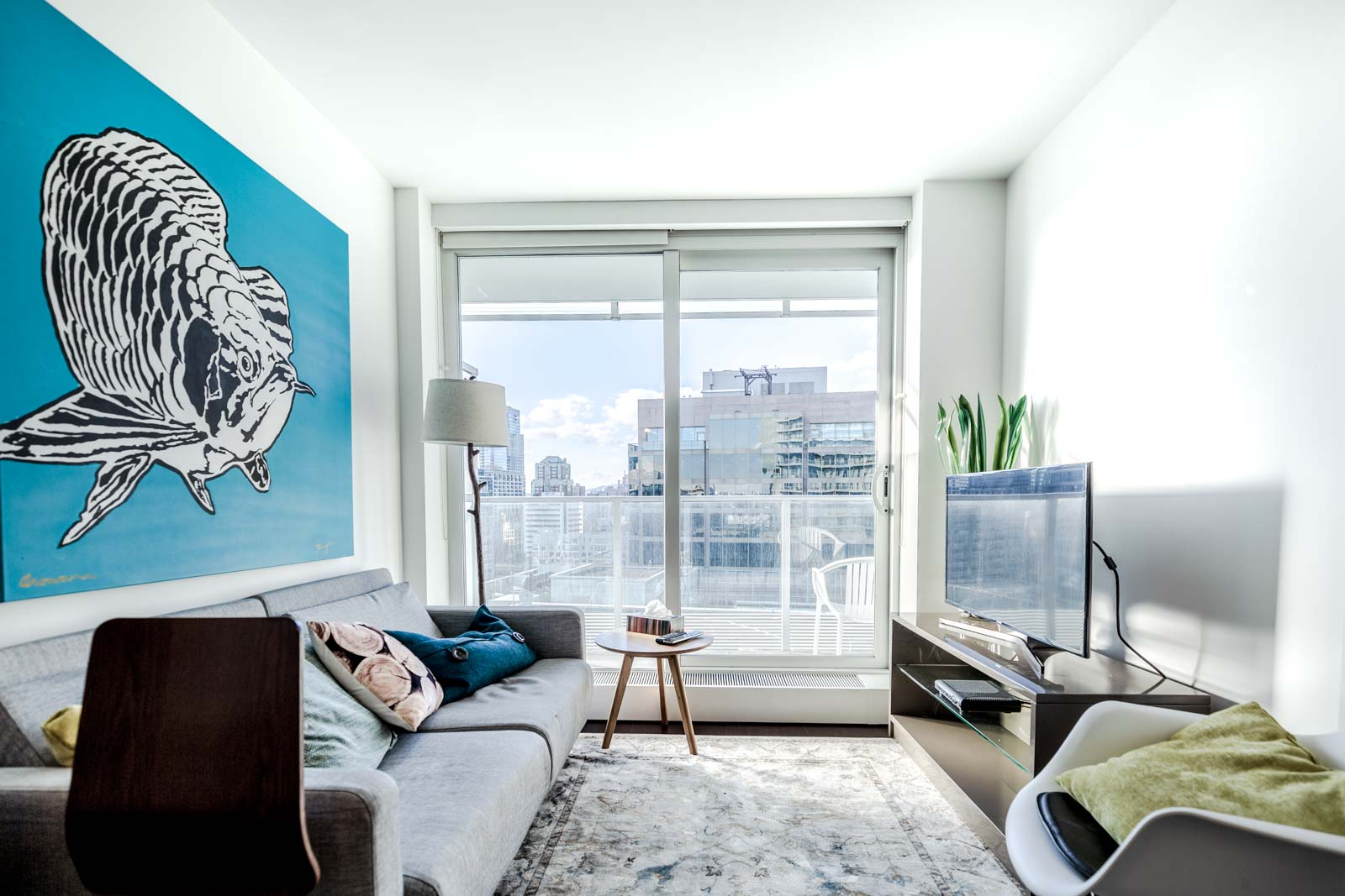 Furnished living room with view at Downtown Vancouver condo rental.