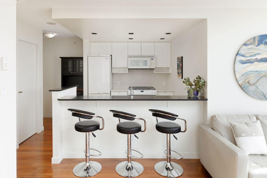 Kitchen and dining area of Downtown Vancouver condo rental managed by Birds Nest Properties.