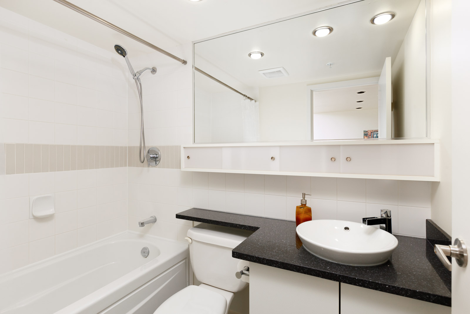 Bathroom with black counter tops in Downtown Vancouver condo rental managed by Birds Nest Properties.