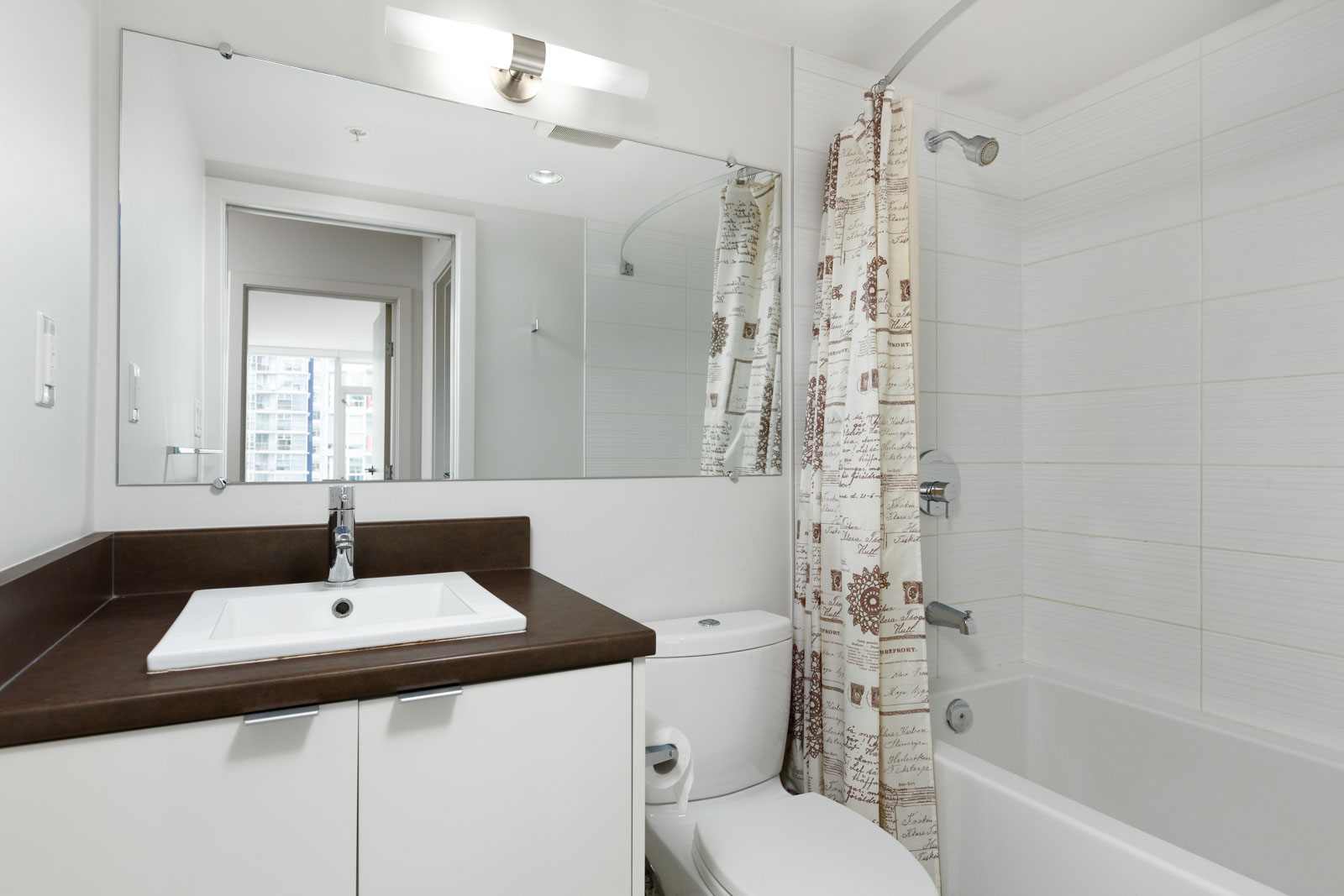 Bathroom at furnished Downtown Vancouver condo managed by Birds Nest Properties.