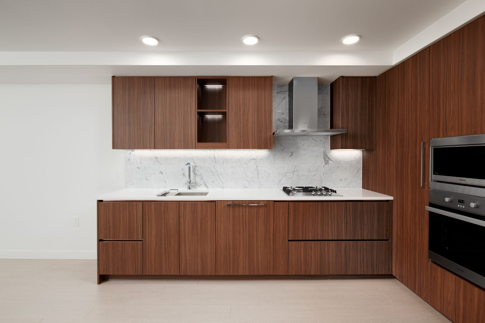 Kitchen with stainless steel appliances in luxury Vancouver rental condo.