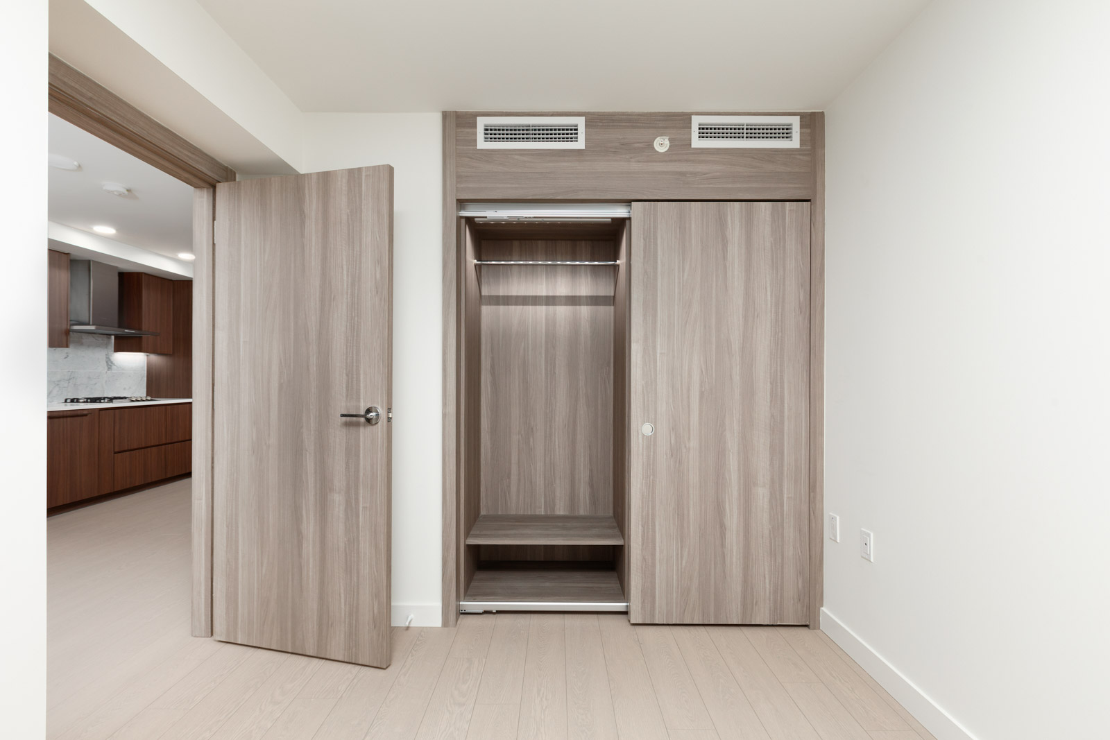 Bedroom and closet in Vancouver luxury condo rental managed by Birds Nest Properties.