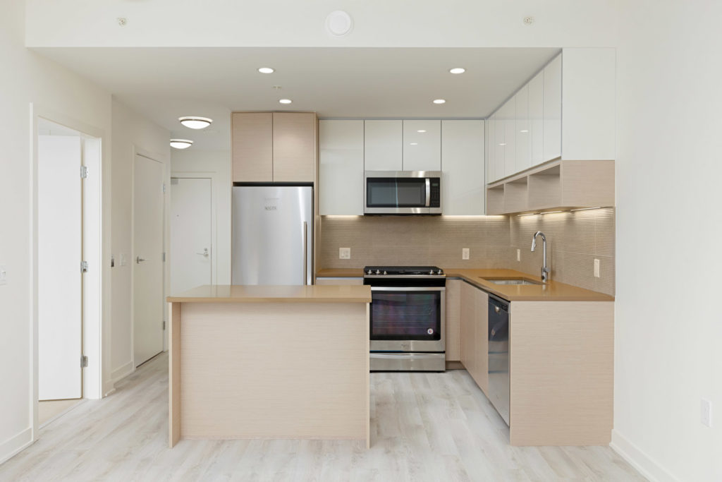 Kitchen with stainless steel appliances in Burnaby Mountain rental condo.