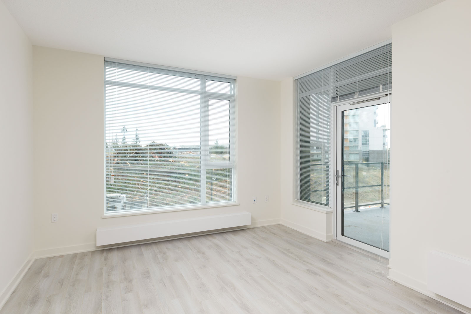 Room with view and access to private balcony at Burnaby Mountain condo.