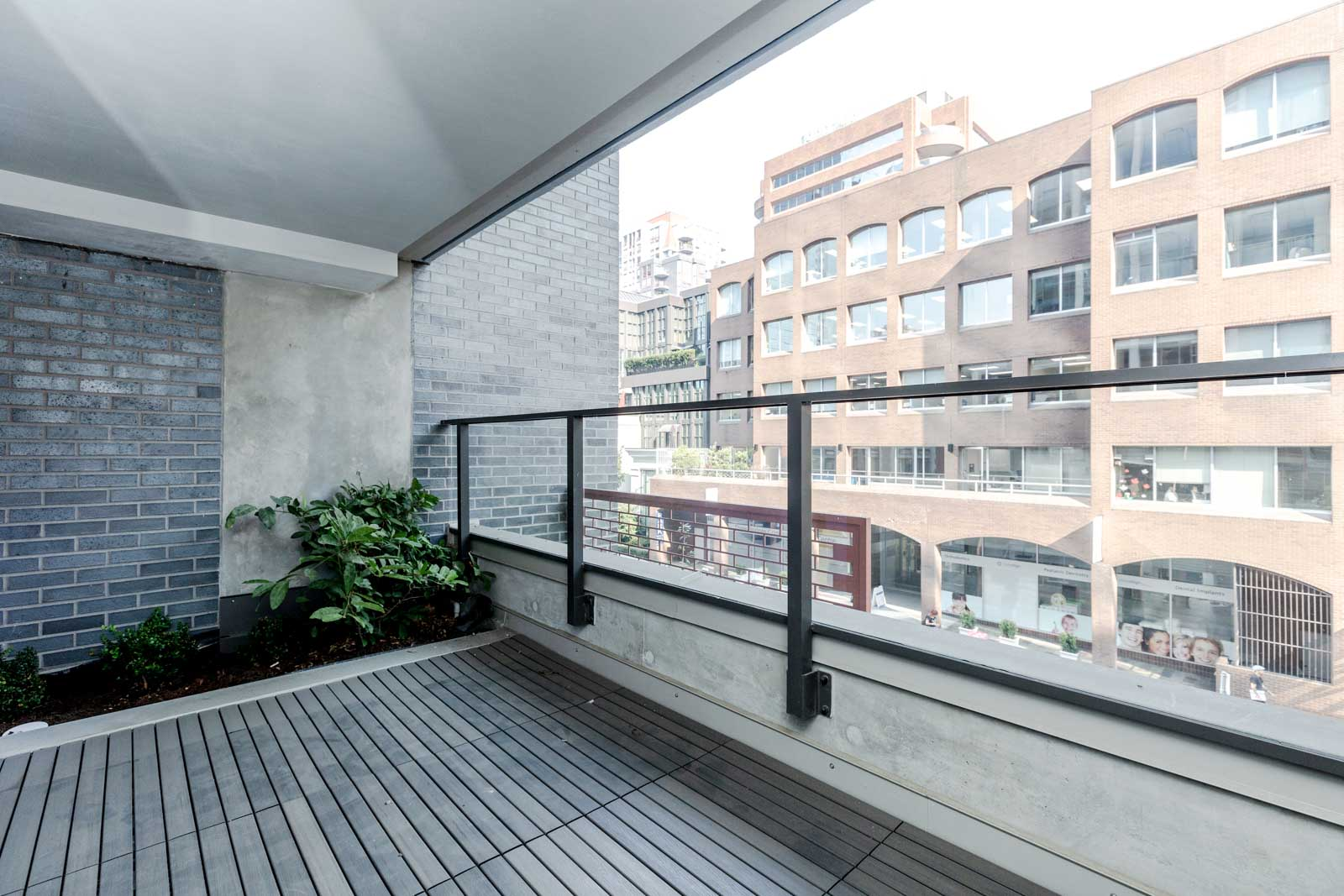 Private balcony with views of the city at Downtown Vancouver rental condo.