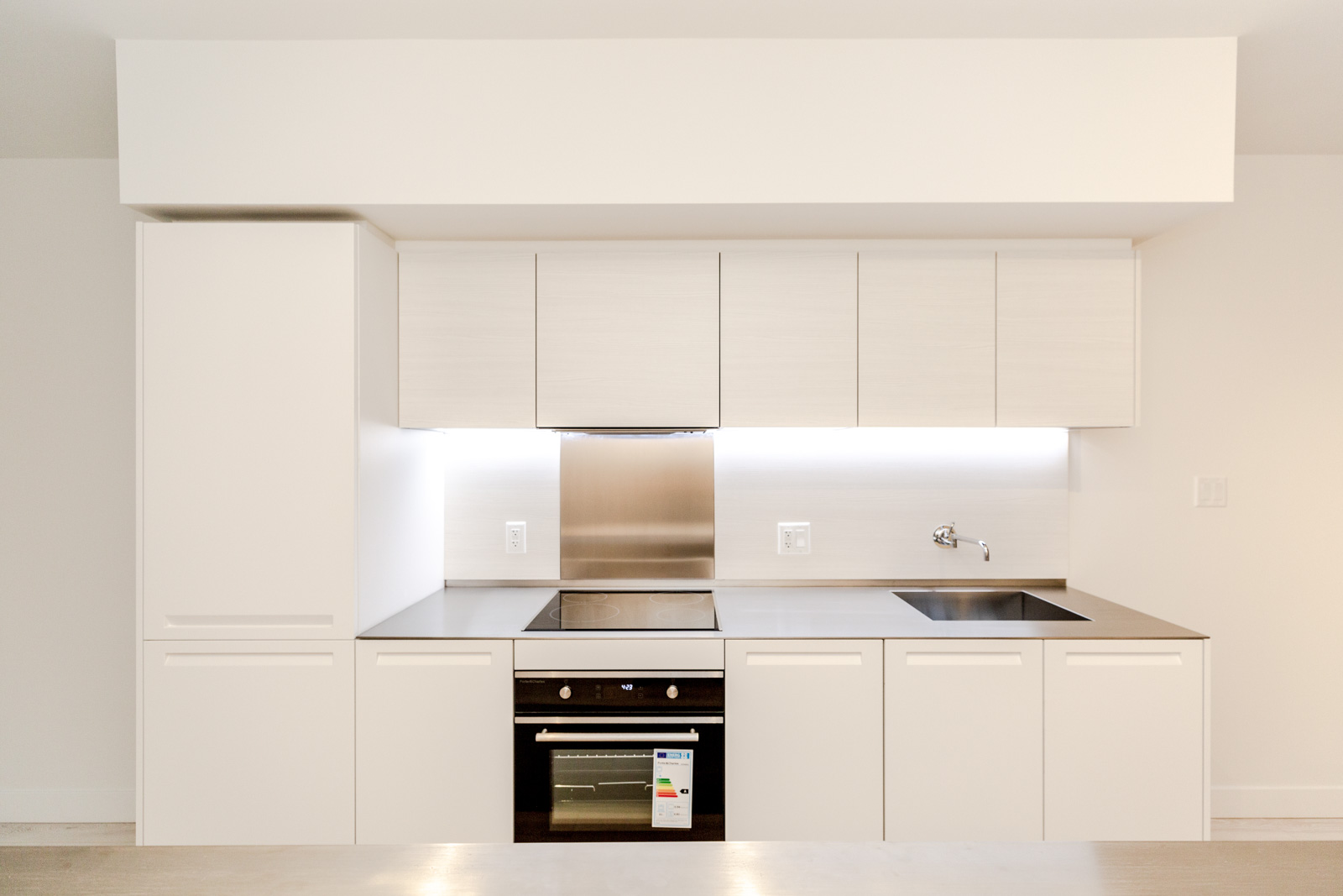 Kitchen with stainless steel appliances in Downtown Vancouver rental condo.