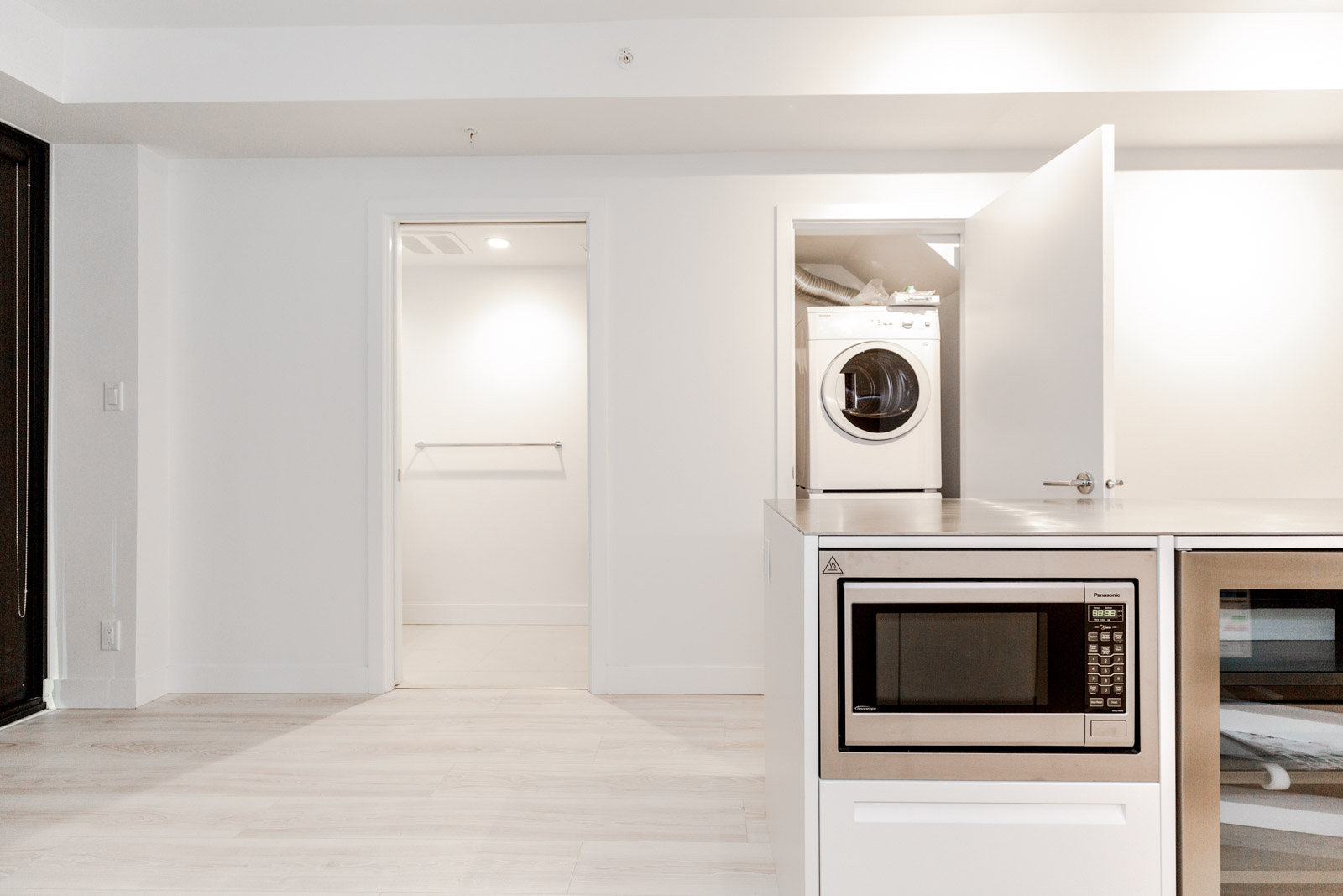 Washer and dryer room in Downtown Vancouver rental condo.