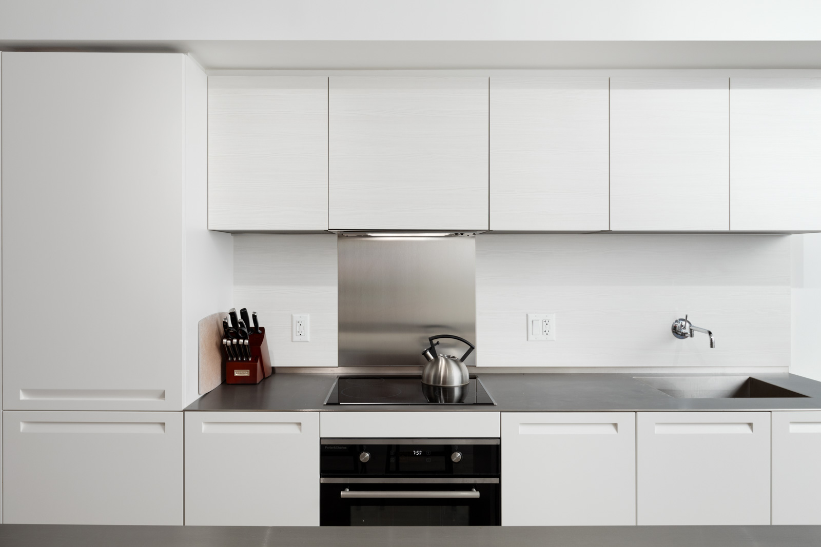 Kitchen with white cabinetry at Downtown Vancouver rental condo.