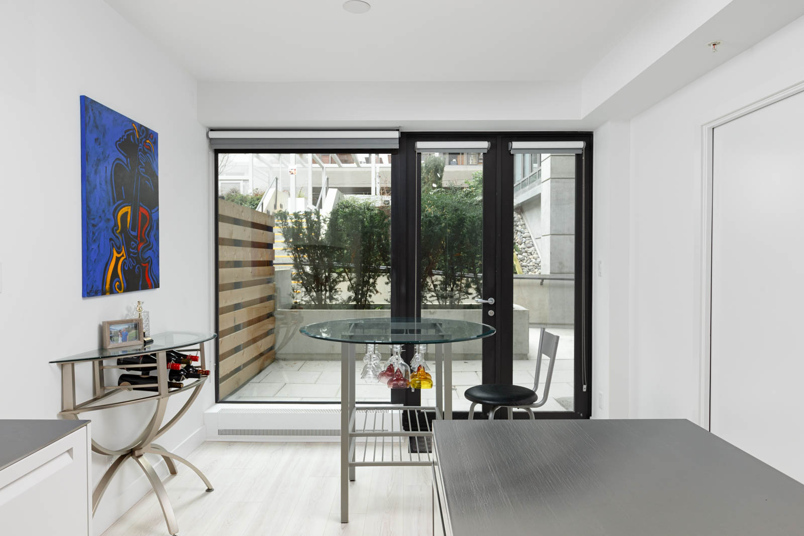 Dining area with access to terrace at Downtown Vancouver rental condo.