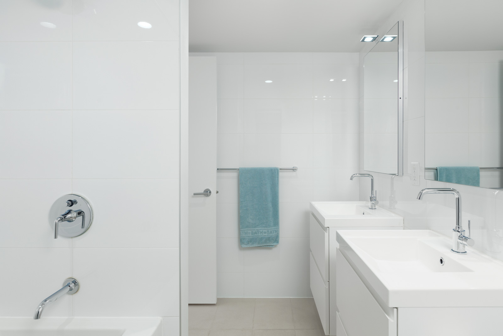 White tiled bathroom at Downtown Vancouver rental condo.