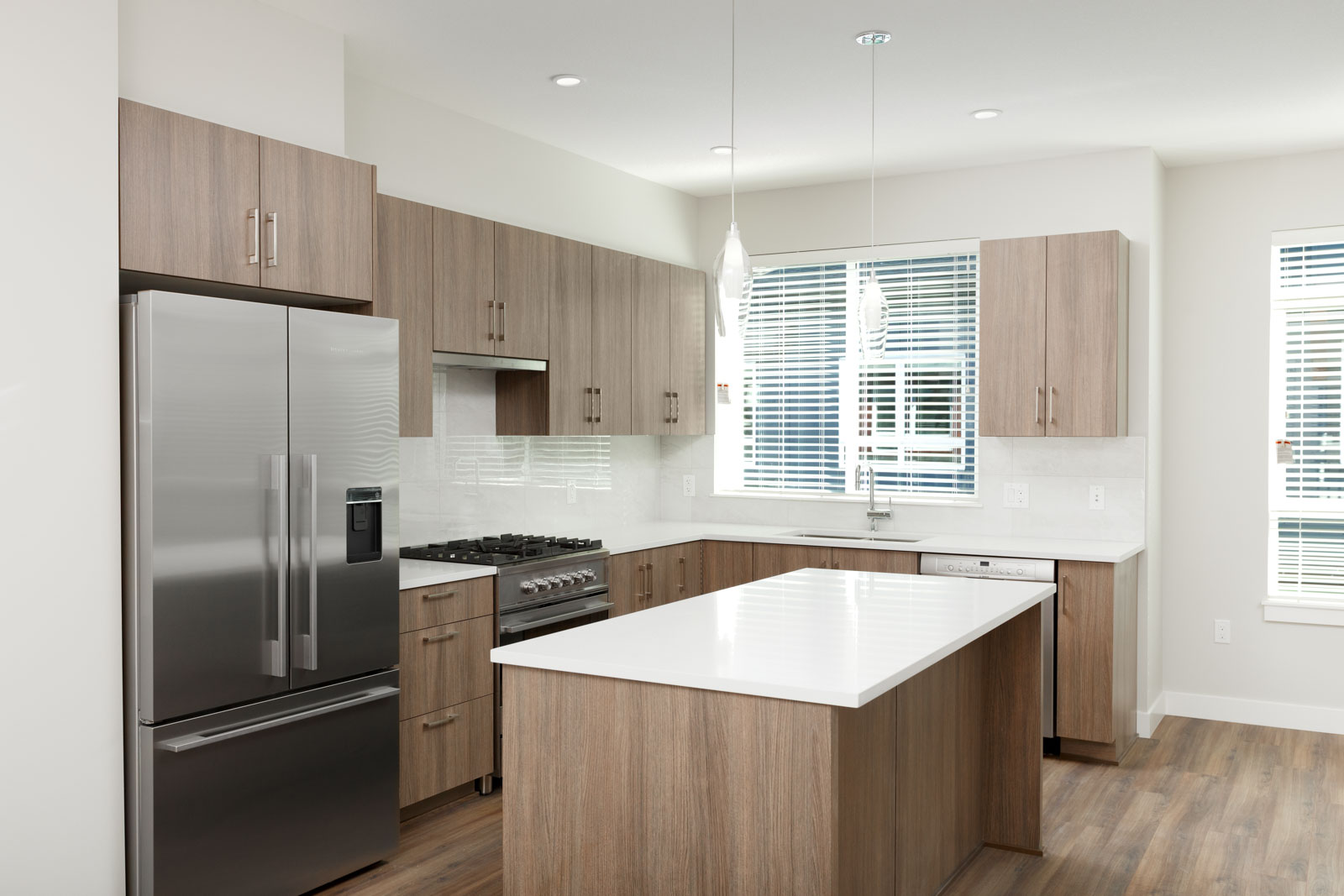 Kitchen with stainless steel appliances in luxury Richmond rental townhome.