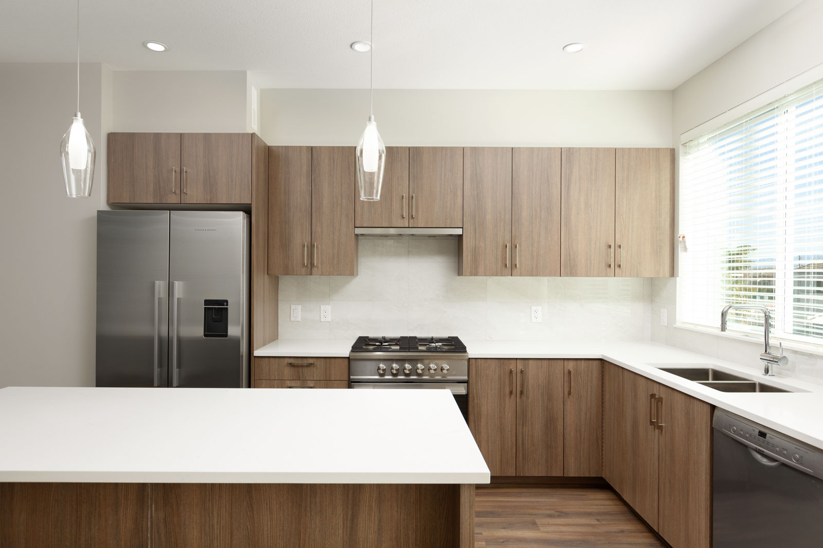 Newly renovated kitchen with butternut wood cabinetry in Richmond luxury rental townhome.