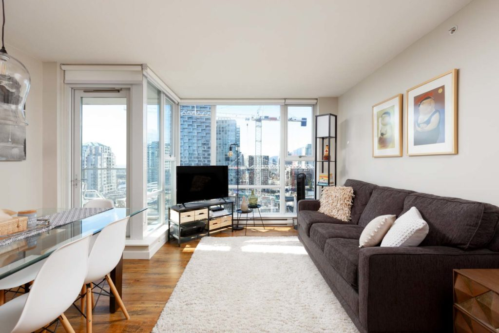 Living area with view in Yaletown Vancouver rental condo.