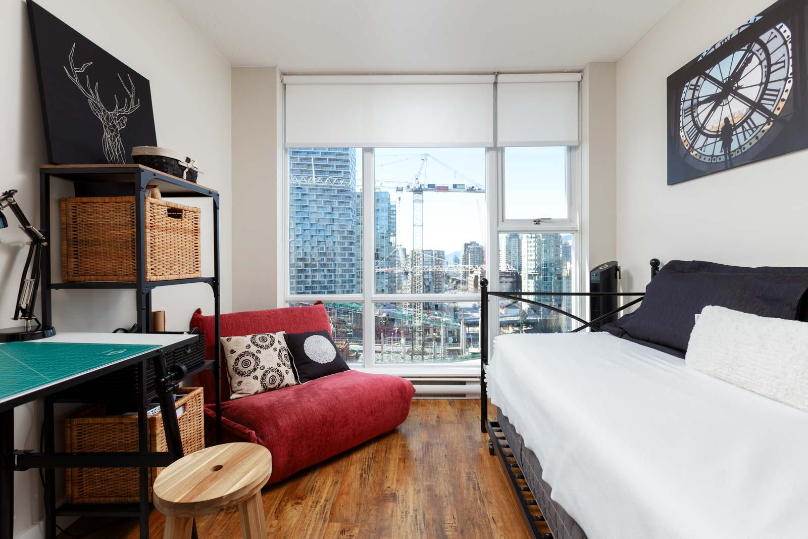 Bedroom in Yaletown Vancouver condo with view.