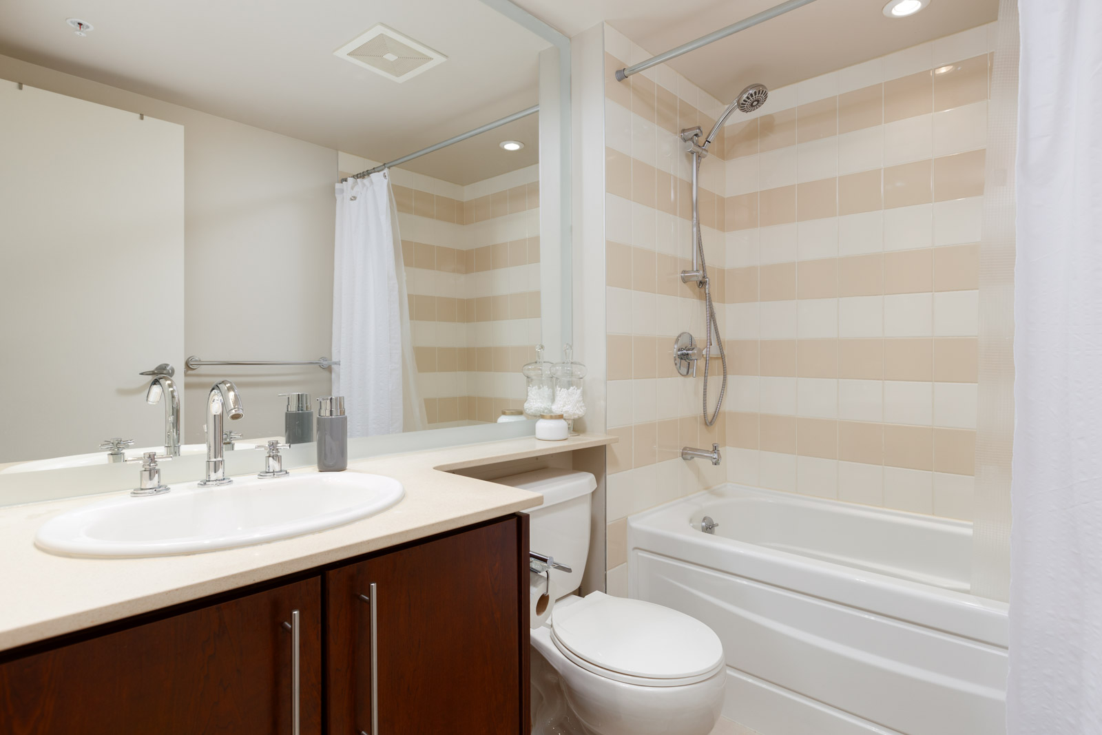 Bathroom with striped tiling in Yaletown Vancouver rental condo.