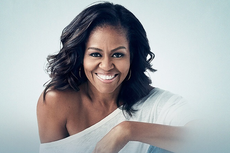 Michelle Obama headshot with blue background