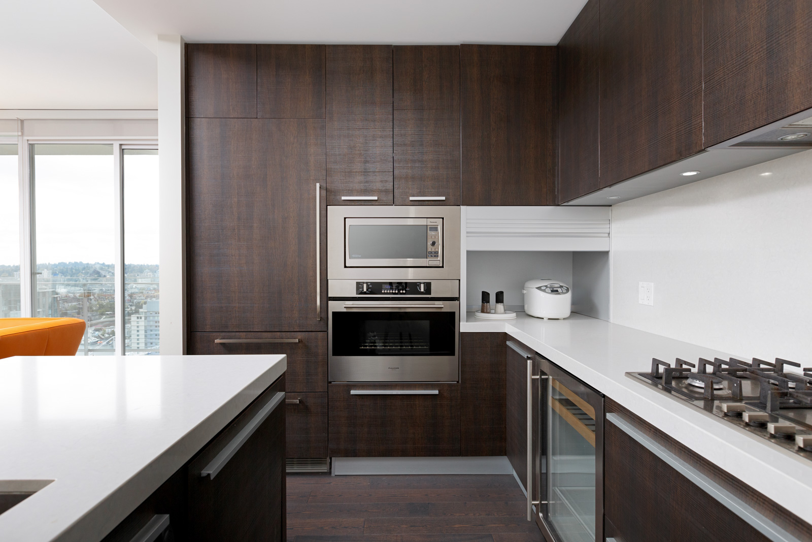 Kitchen with stainless steel appliances and dark cabinetry in Vancouver rental condo.