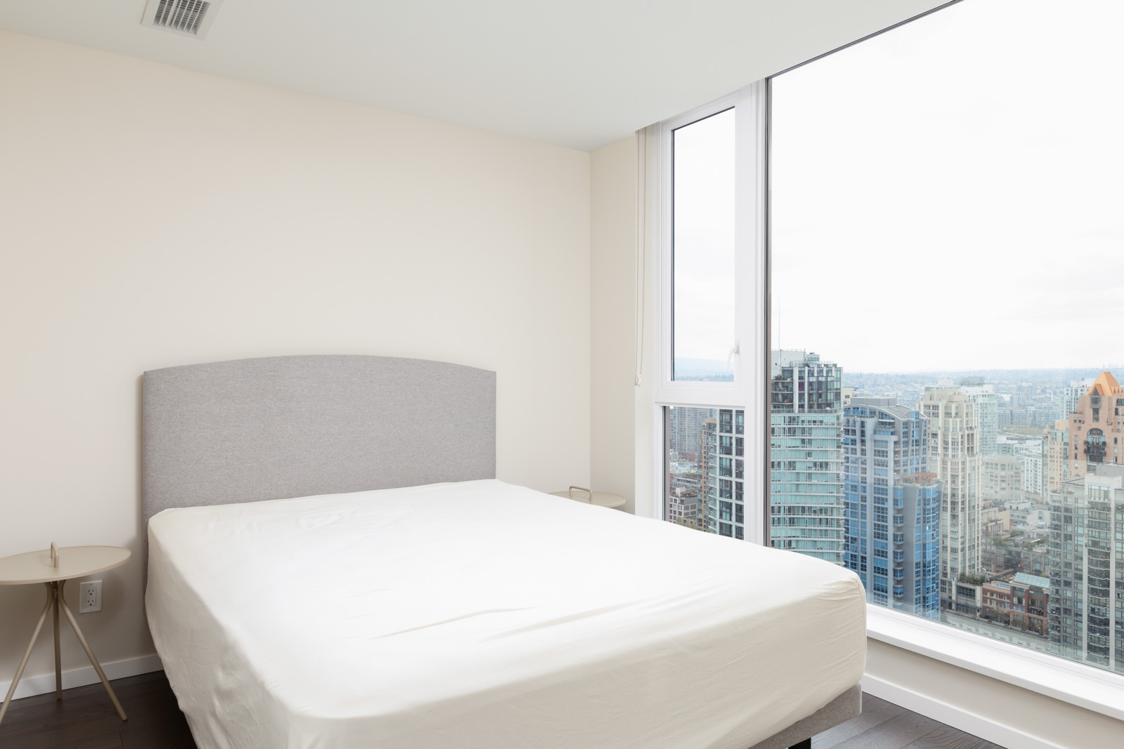 Bedroom in Vancouver rental condo with view.