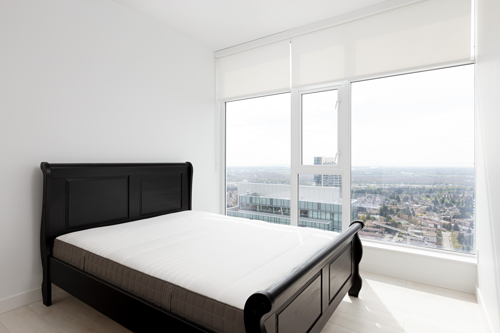 Bedroom with view in Metrotown condo