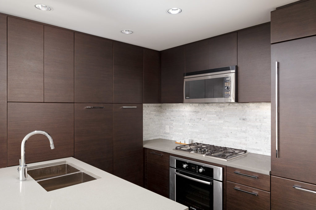 Kitchen with stainless steel appliances in UBC rental condo.