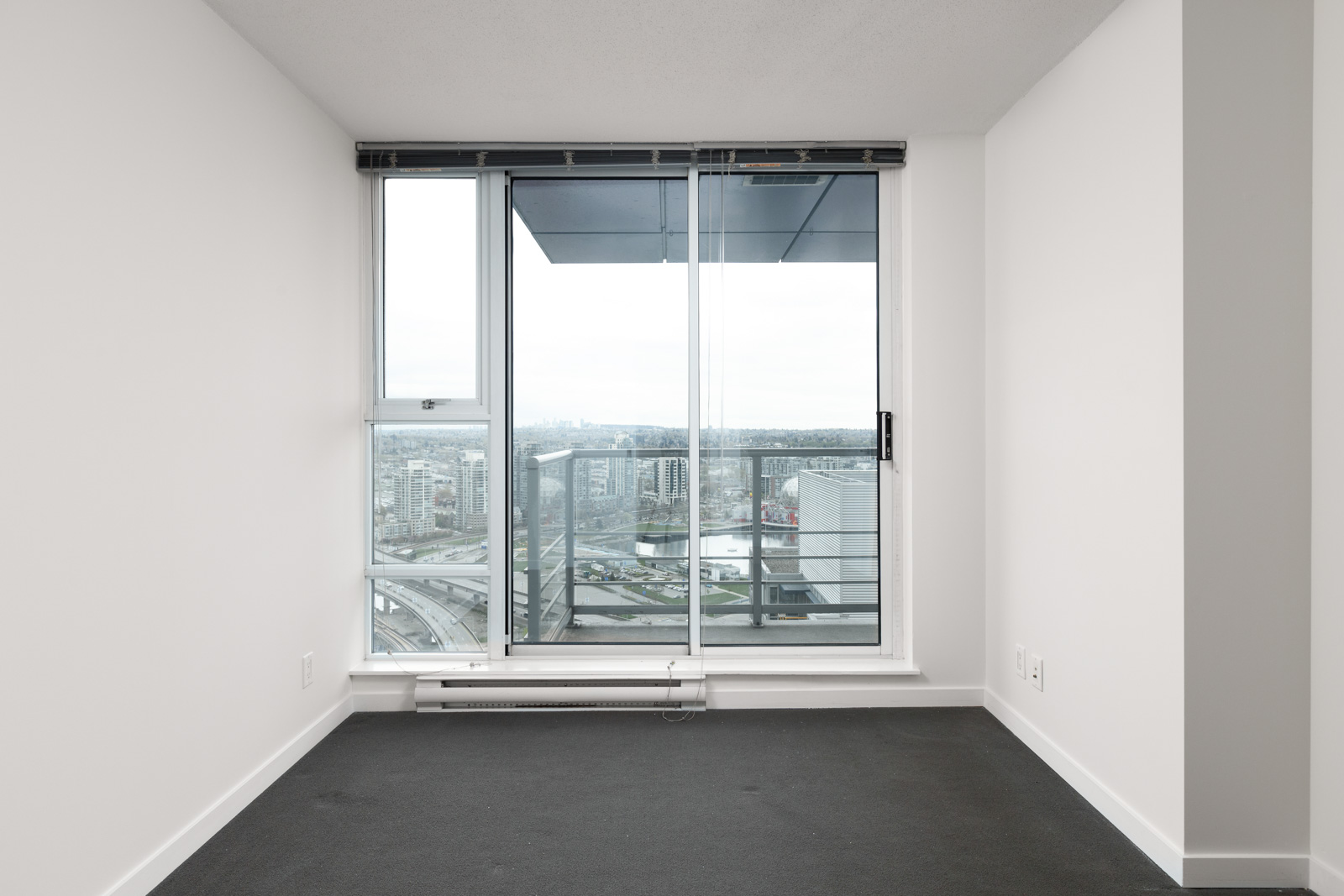 Bedroom with access to private balcony of Downtown Vancouver rental condo.