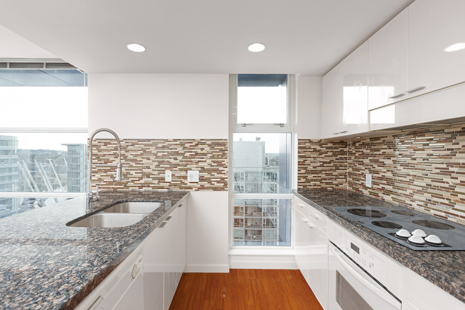 Kitchen with granite countertops inside Downtown Vancouver condo.