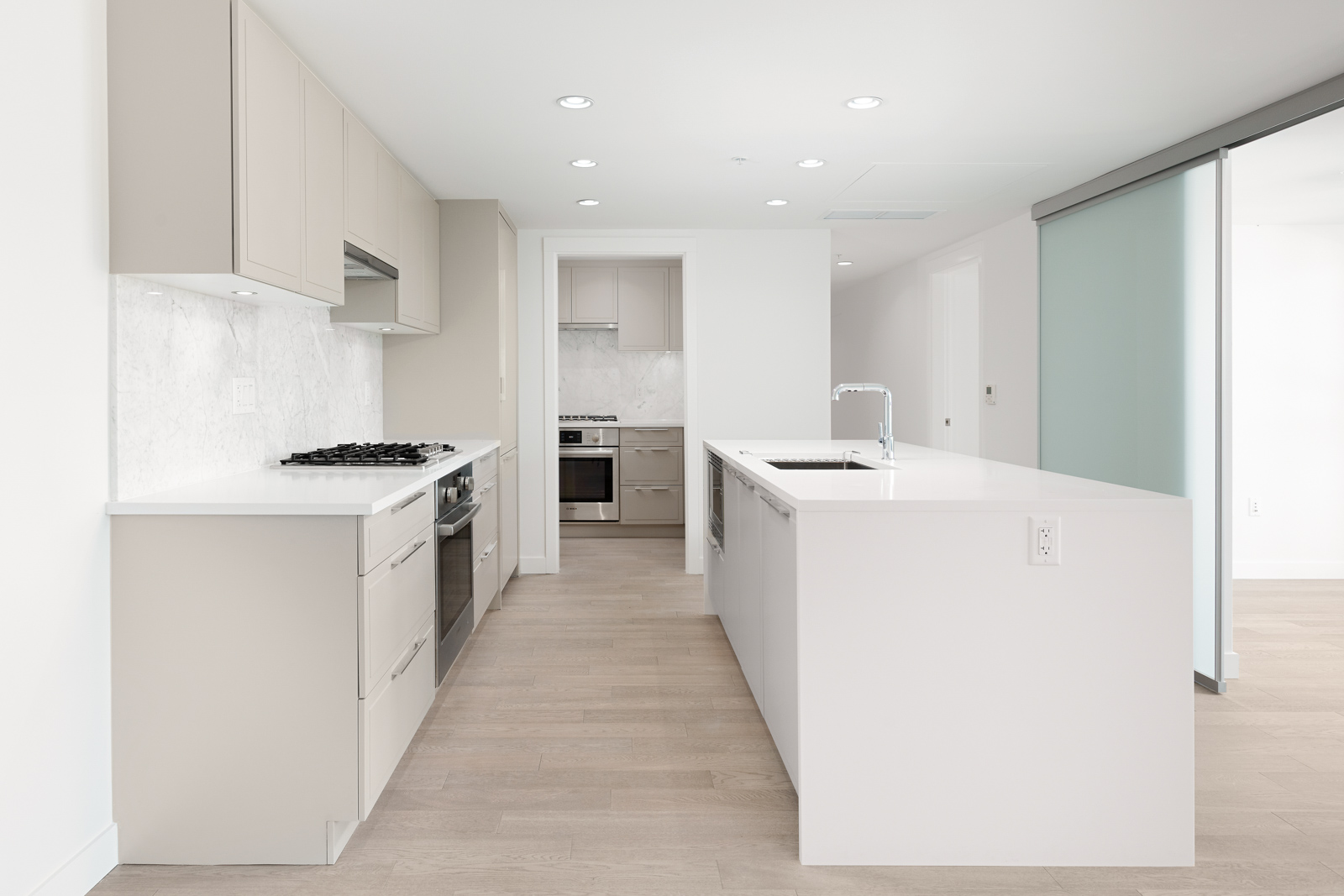 Kitchen with stainless steel appliances in Vancouver's Marpole community.