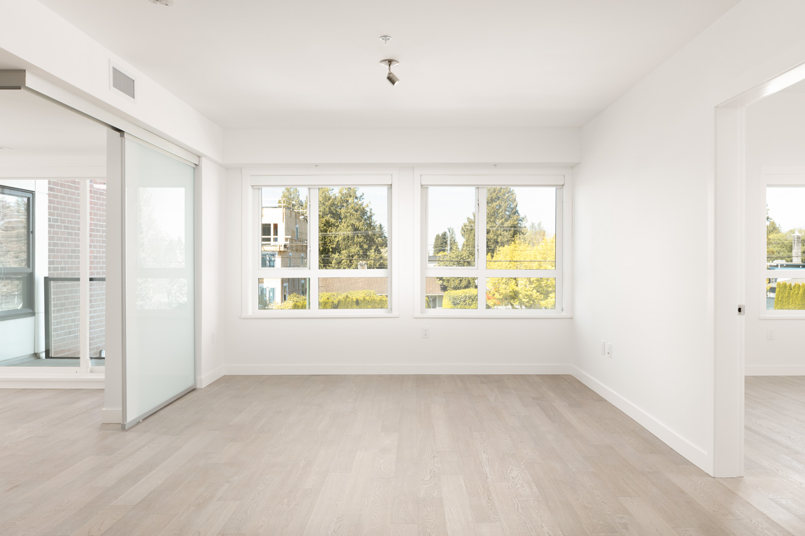 Bedroom with ash hardwood floors inside Vancouver rental townhome with views.