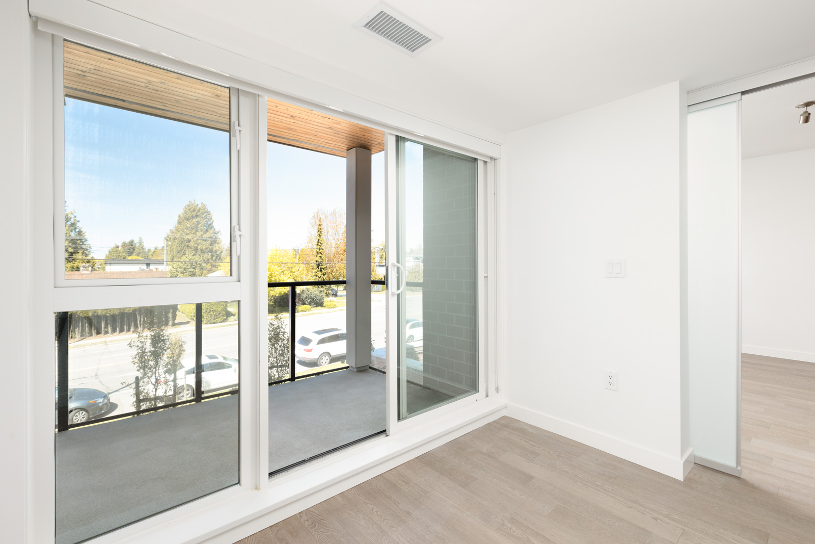 Sliding glass doors open onto private balcony of Vancouver rental townhome.