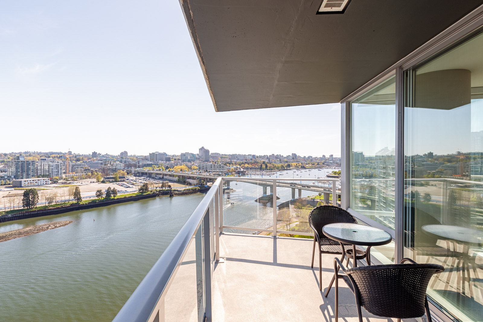 Private balcony of Vancouver luxury rental condo with waterfront views.