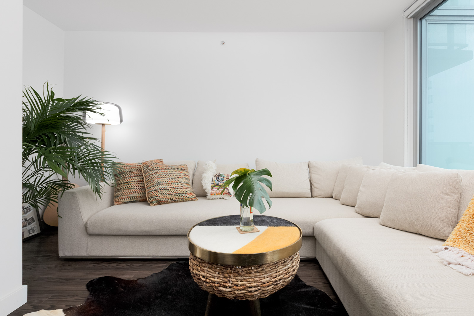 trendy white couch in home managed by Birds Nest Properties