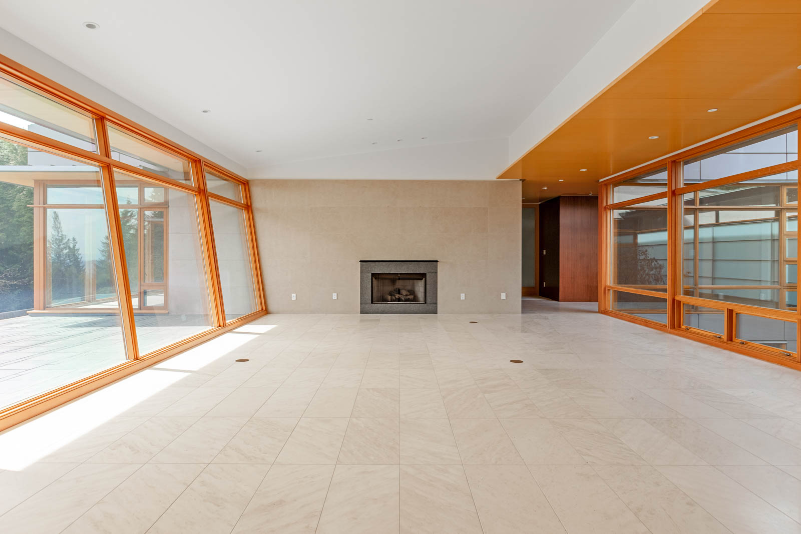 Living area and fireplace inside West Vancouver luxury rental home.