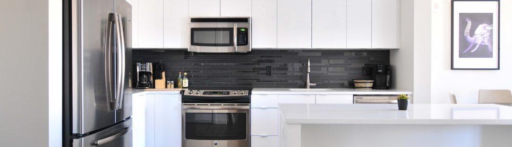 New stylish kitchen with bar stools and large fridge